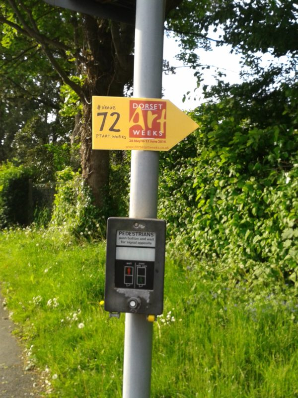 sign on a lamp post for dorset art weeks 2016 showing the way to venue 72 phoebe thomasson art