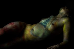 hybrid skin reclining nude with art by phoebe thomasson photo by adam white